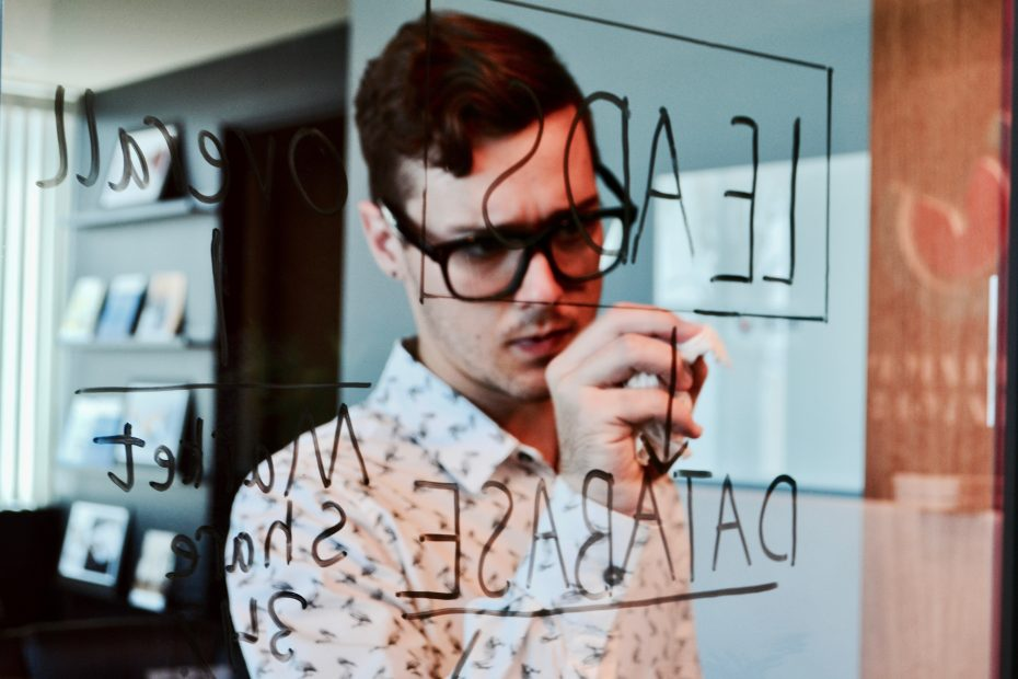 software expert drawing on a crystal wall